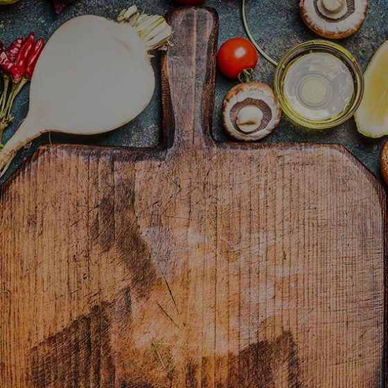 chopping board with cooking ingredients around it